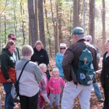 Hike Leader Bernard talking with children about things we find along the trail.