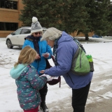 Young participants getting stickers for their personal hiking journal.
