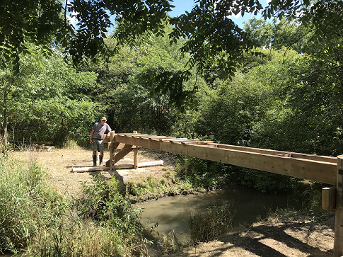 Thurs  July 30 - Designer and project boss, Ted, leaning on bridge -10