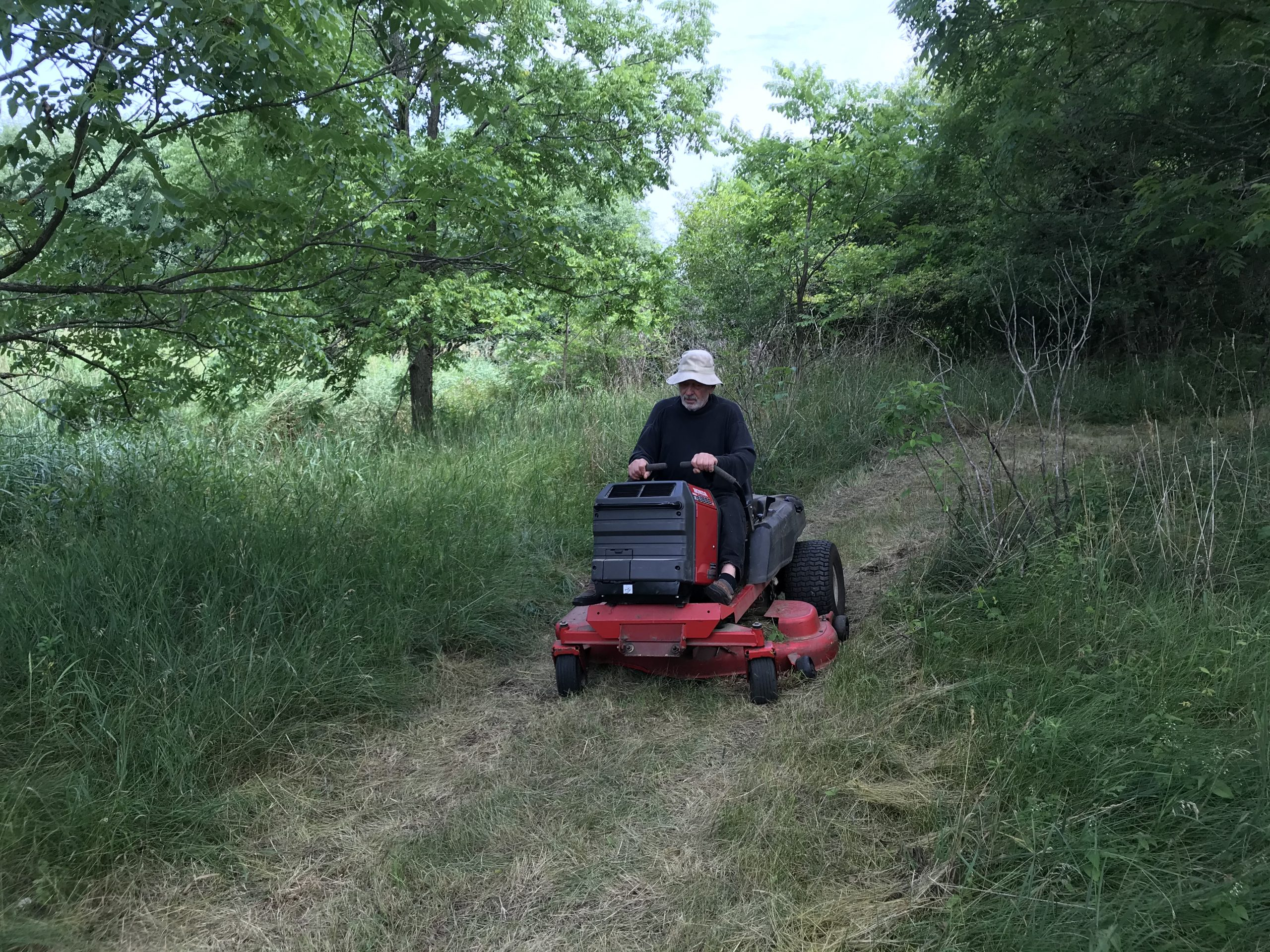 Tues July 21 - Landowner Peter towing out the generator for us